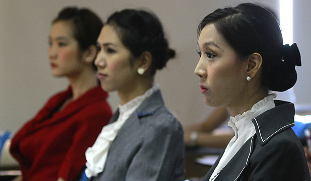 Transsexual flight attendants attend a make-up training session at PC Air office in Bangkok.