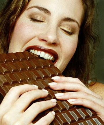 LIKE A DRUG: Chocolate stimulates the release of serotonin, the body's happiness hormone.