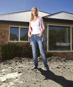 Laura McConchie in the backyard of her   condemned  Bexley home.