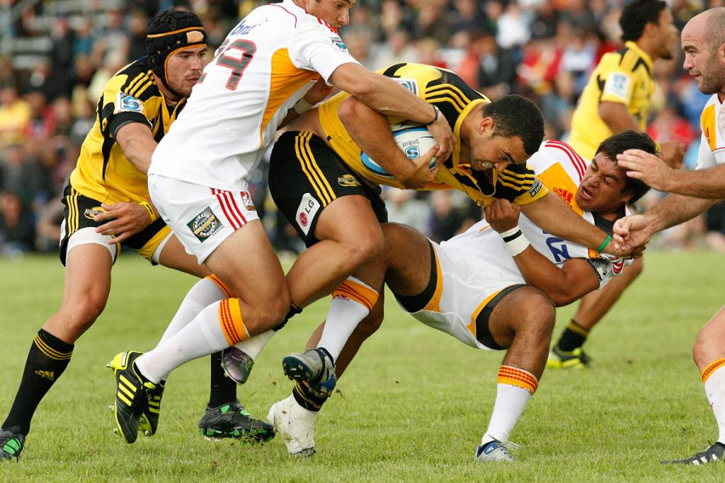 Hurricanes player Charlie Ngatai is tackled in their warm-up match against the Chiefs.