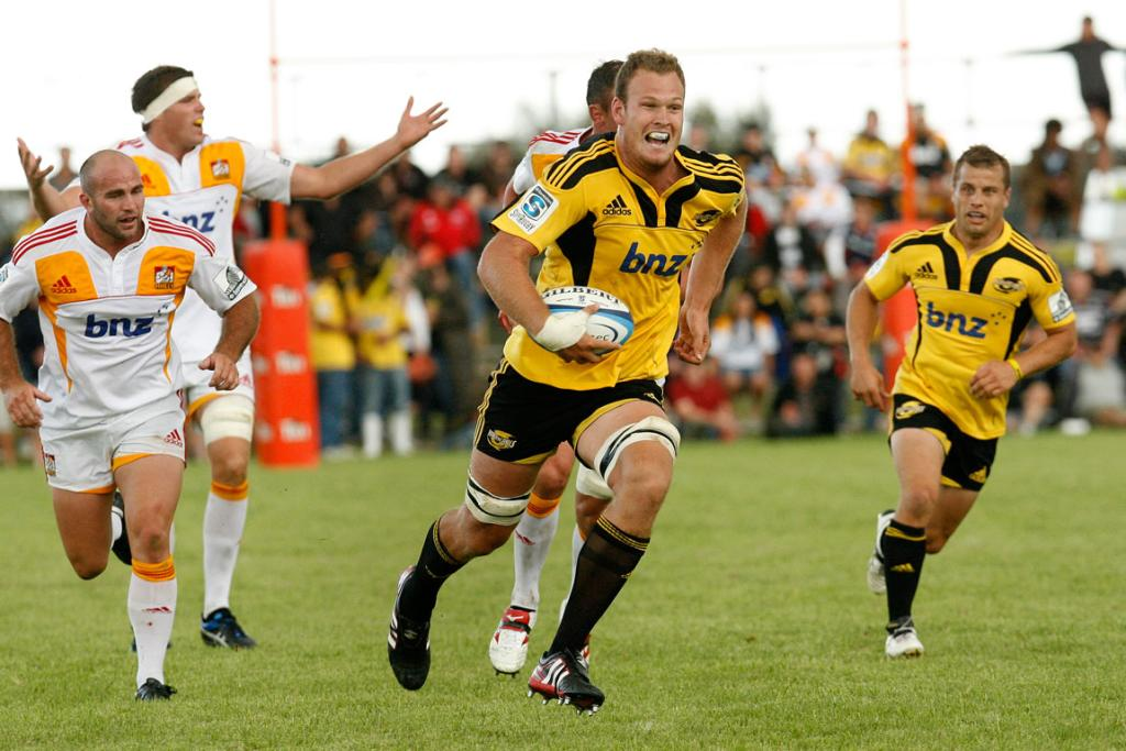 Hurricanes player James Broadhurst comes in to score in their warm-up match against the Chiefs.