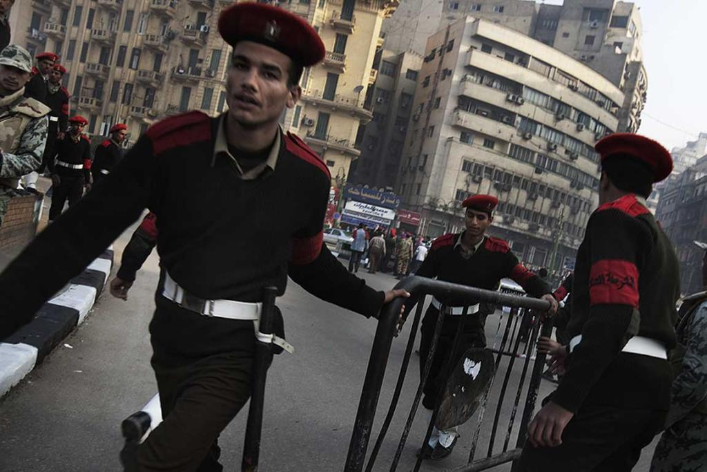 Egyptian soldiers remove the few remaining barricades in Cairo's Tahrir Square.