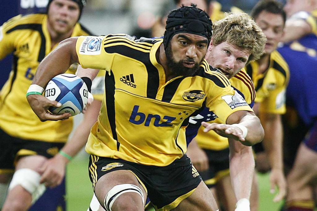 Always dangerous on attack, Hurricanes flanker Victor Vito tries to break away from Adam Thomson.