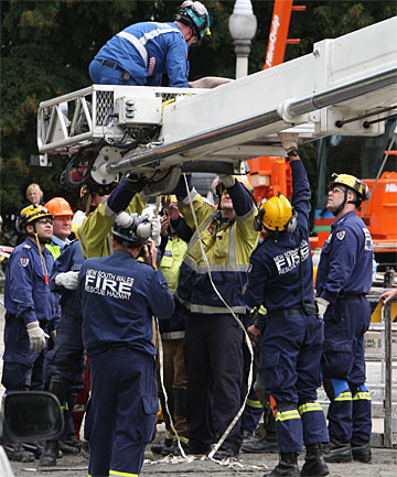 HERE TO HELP: Members of an Australian specialist urban search and rescue team help with the rescue effort in Christchurch.