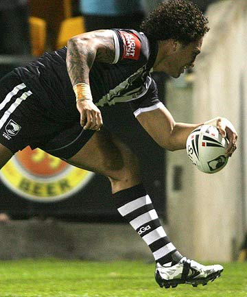 Kiwis winger Manu Vatuvei scores his second try against Samoa just moments before leaving the field injured.