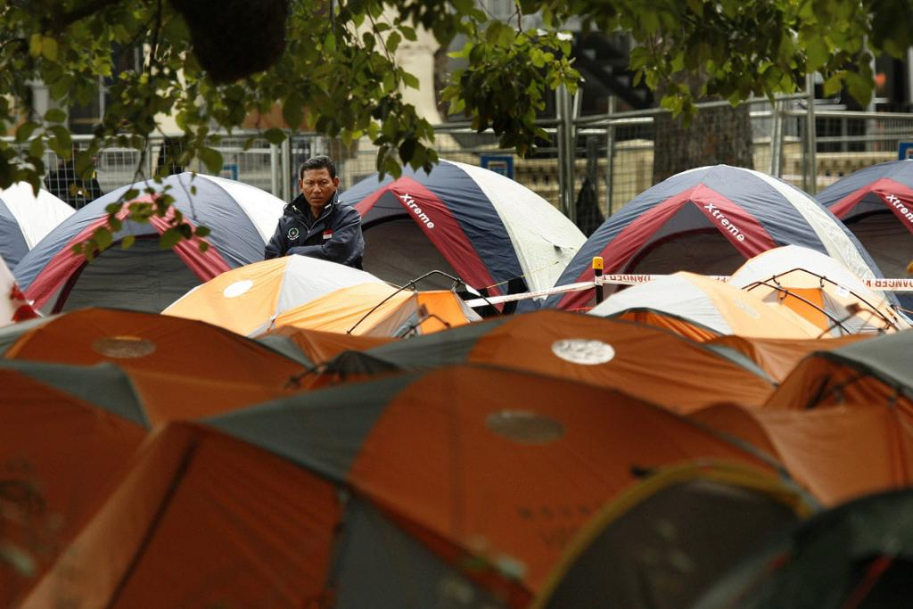 A rescue worker in tent city at Latimer Square.