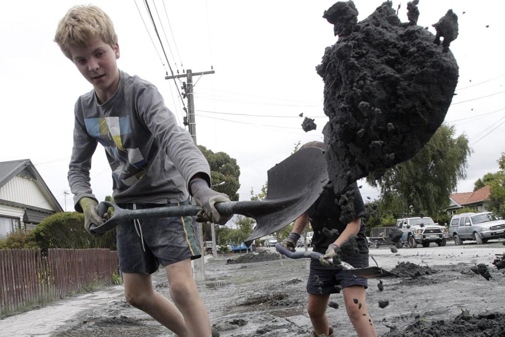 Chris Crishom helps clean up the streets of Christchurch.