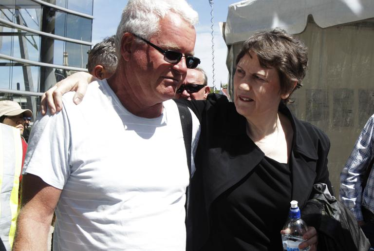 Helen Clark comforts Murray Shaw, the deputy chair of New Zealand On Air, outside the Civil Defence headquaters in Christchurch today.