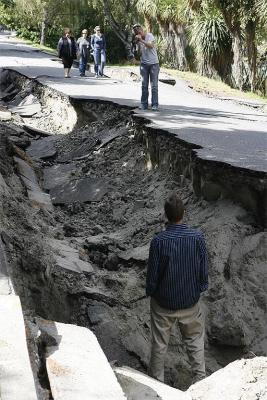 Locals explore the quake damage in River Road, Richmond.