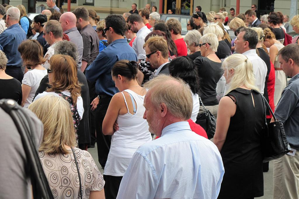 Hundreds of people gathered outside Palmerston North's All Saints Church to observe the two minutes' silence.