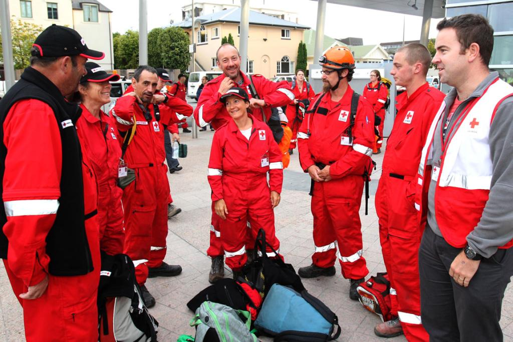 The Nelson Redcross Response team, Hugh Leckie, Isabelle Lotscher, Cheynne Leslie, David van der Peet, Debbie Preest, Steve King, Lee Bradley and Tasman area manager Fraser Benson prepare to head out to the suburbs of Christchurch this morning.