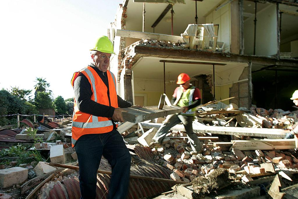 Paddy Snowden salvages what he can from the ruins of his historic home in Linwood Avenue.