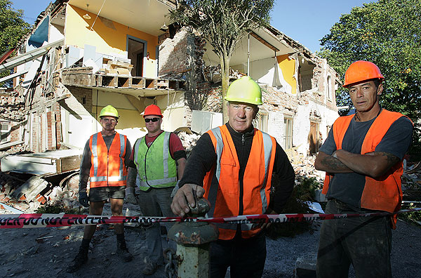 The destruction of Paddy Snowden historic home in Linwood Ave. Paddy (3rd left) and men from his demolition crew. From left, Clarrie Beran, Mark Cosgrove, paddy, and James Tuhikarama