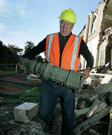 Paddy Snoden retrieves what he can from the ruins of his heritage Linwood Ave home.
