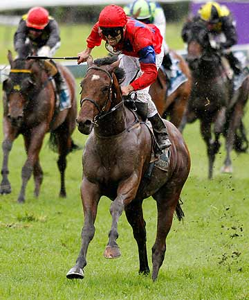 Jimmy Choux, with Jonathan Riddell riding, wins the New Zealand Derby at Ellerslie.