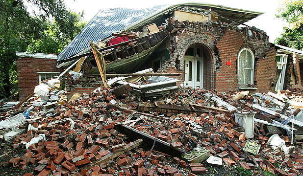 A brick house lies in ruins in the Christchurch suburb of Huntsbury.