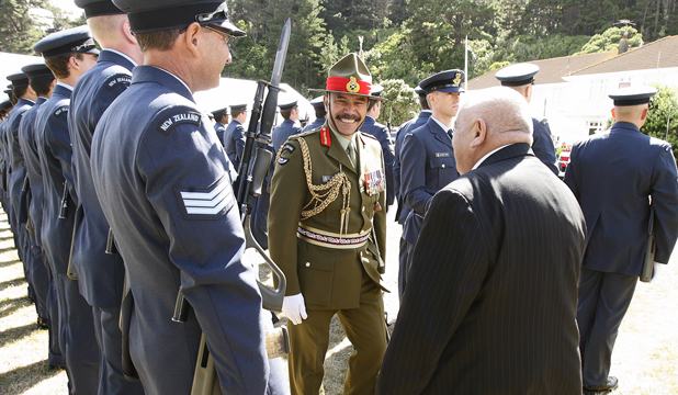 Public office: Inspecting a defence force guard of honour. Below, new Governor-General Jerry Mateparae with Prime Minister John Key.