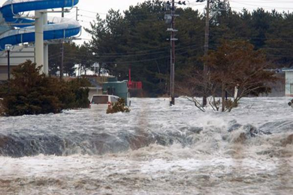 The area is flooded by tsunami in Iwaki, Fukushima Prefecture (state) as Japan was struck by a magnitude 8.9 earthquake off its northeastern coast.