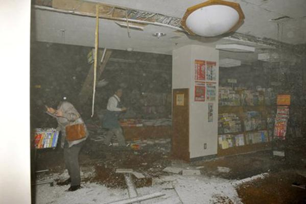 People at a book store react in Sendai, northern Japan as an earthquake hits Friday.