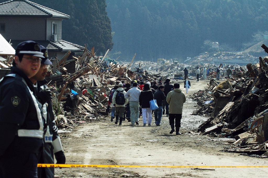 Residents return into the restricted area to look at their quake-damaged homes in Miyagi prefecture.