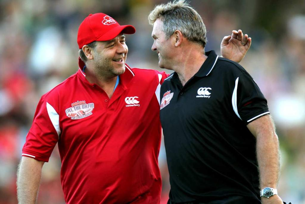 Cousins and combatants, actor Russell Crowe and former New Zealand captain Martin Crowe, walk off the Basin Reserve.