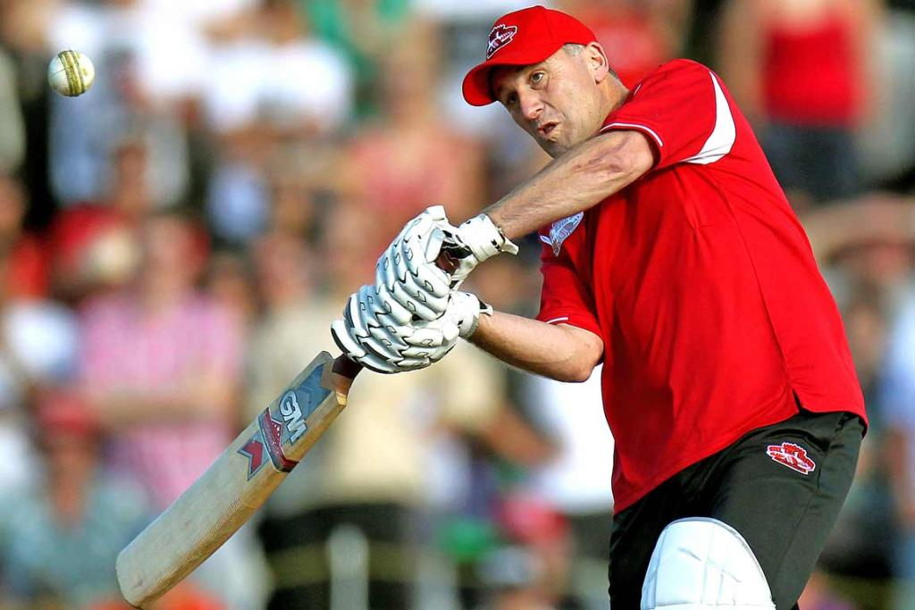 New Zealand Prime Minister John Key swings for the fence against Shane Warne.