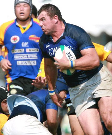 ON THE CHARGE:  Paul Miller playing for the Kurita Water Industries club in Japan.