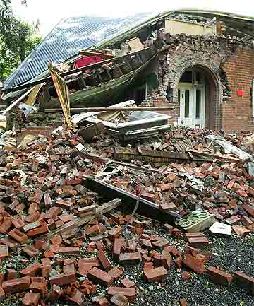 RED STICKER: A brick house lies in ruins in the Christchurch suburb of Huntsbury.