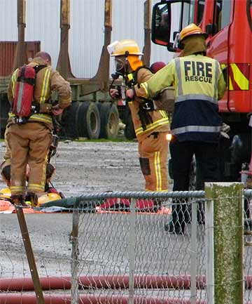 HELP ARRIVES: Emergency services attend a fire at a fertiliser plant at Rooney Earthmoving, Washdyke, about 8.30am yesterday.
