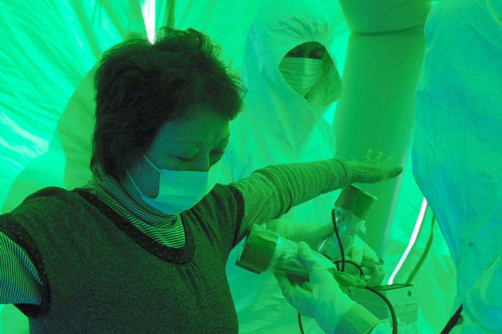 Medical staff use a Geiger counter to screen a woman for possible radiation exposure at a public welfare centre in Hitachi City, Ibaraki.