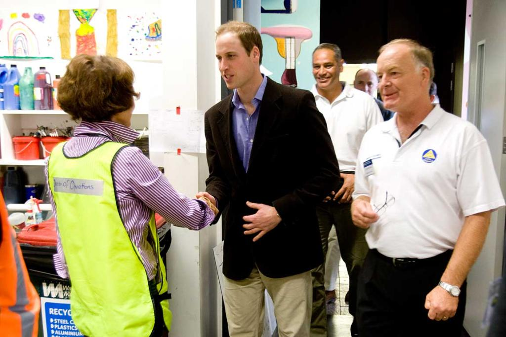 Prince William talks with Jane Parfit, Director of Operations, in quake-ravaged Christchurch.