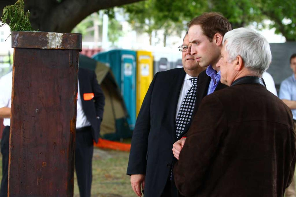 Prince William looks at a plaque made in Christchurch by Australian USAR members.