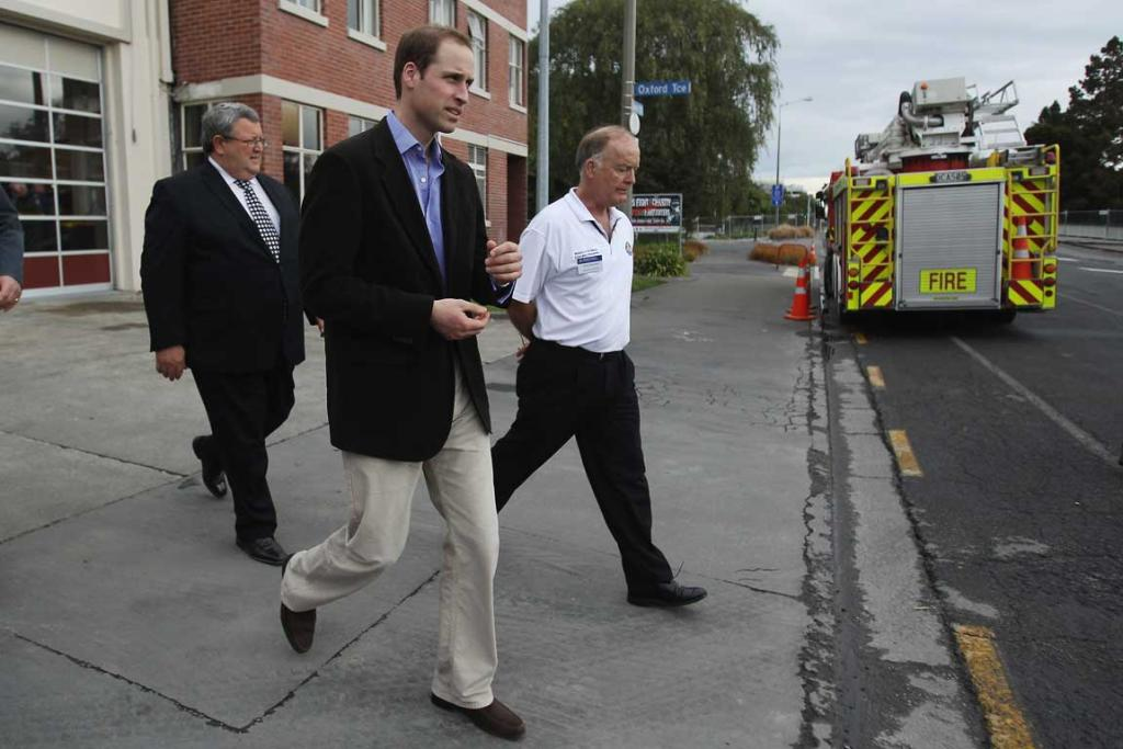 Prince William leaves Christchurch's City Fire Station with Earthquake Recovery Minister Gerry Brownlee and Civil Defence head John Hamilton.