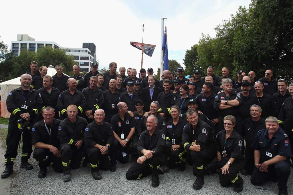 Prince William poses for a group photo with USAR members in Christchurch.