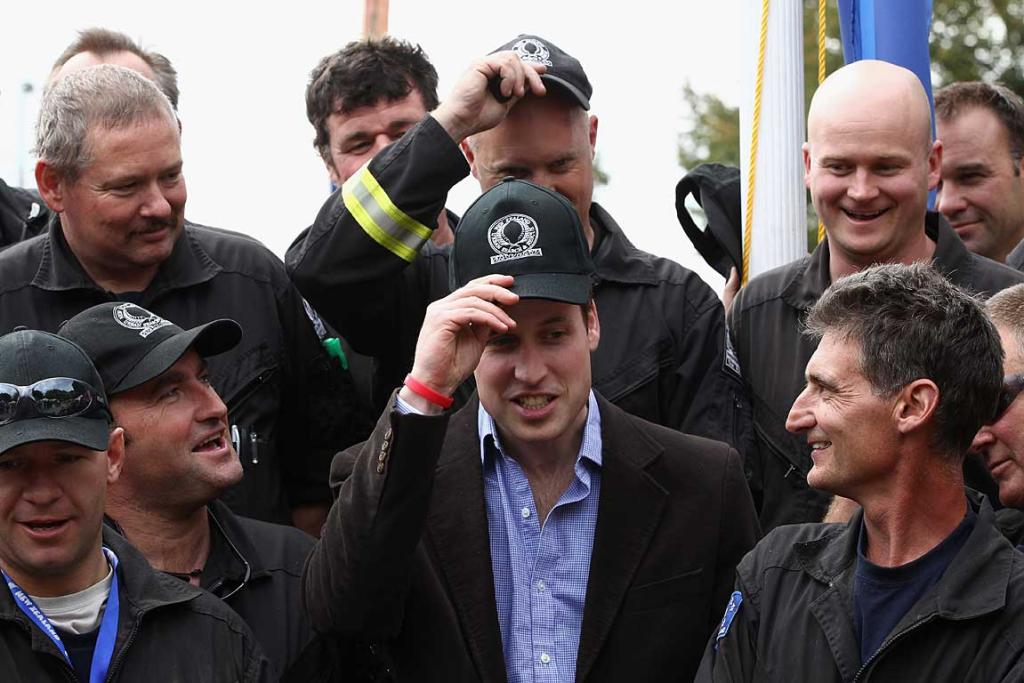 Prince William with USAR members in Christchurch.