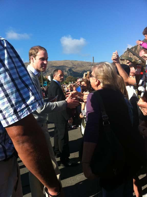 Prince William, left, greets the crowd in Sumner.