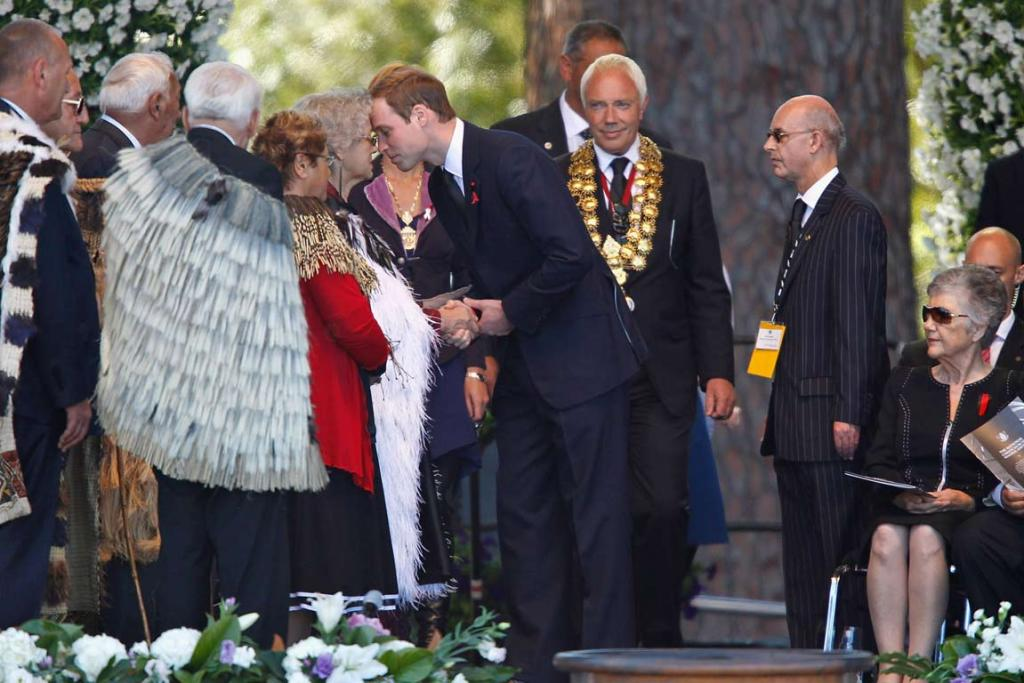 Prince William, followed by Christchurch Mayor Bob Parker, is greeted at the national Christchurch earthquake memorial service.