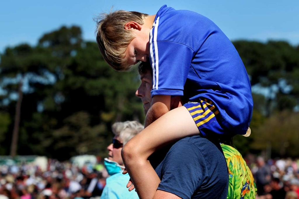 Campbell Sharplin, ten, prays on the shoulders of his father Nigel.
