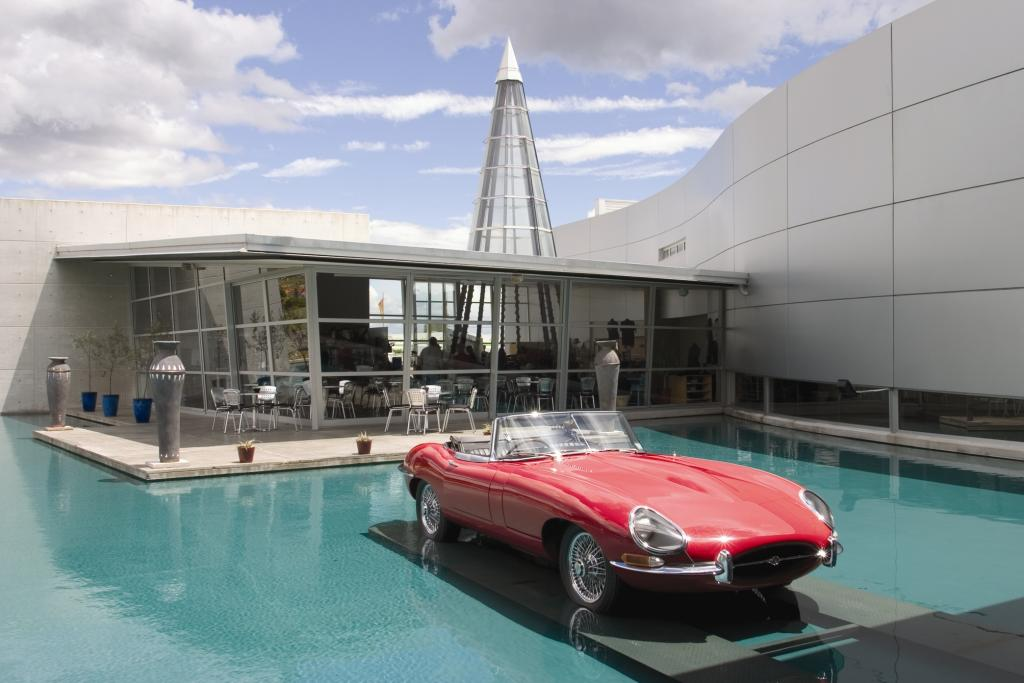 World of Wearable Art museum with 1967 Jaguar E-Type Roadster on display; café in background.