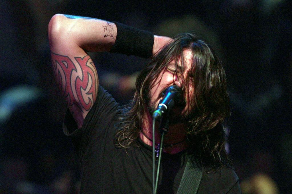 Dave Grohl performs with the Foo Fighters at the Auckland Town Hall.