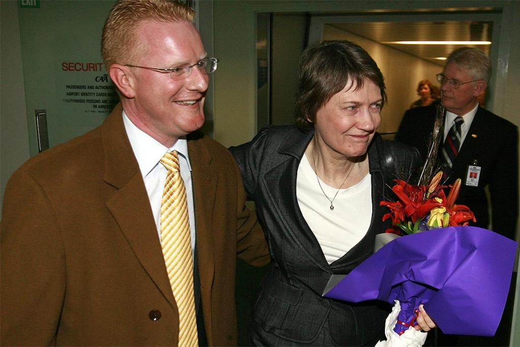 Darren Hughes presents Helen Clark with flowers when she arrived at Wellington Airport, 2008.