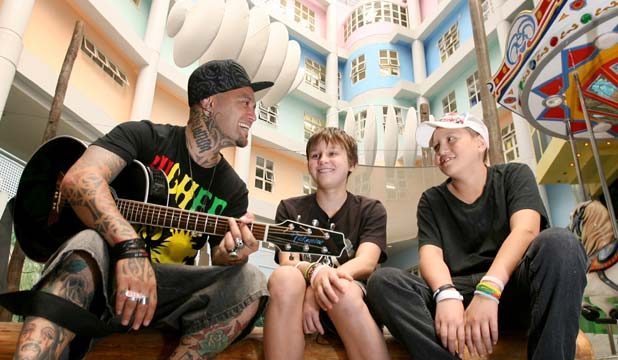 SWEET DREAMS: All proceeds from Tiki Taane's Starship Lullaby go to the Starship Foundation. Tiki is pictured with patients Callum Sellwood, 14, and David Heke, 13.