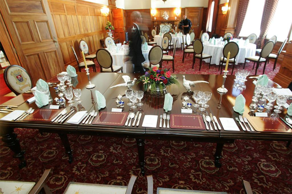 The formal dinning room set for a special function.