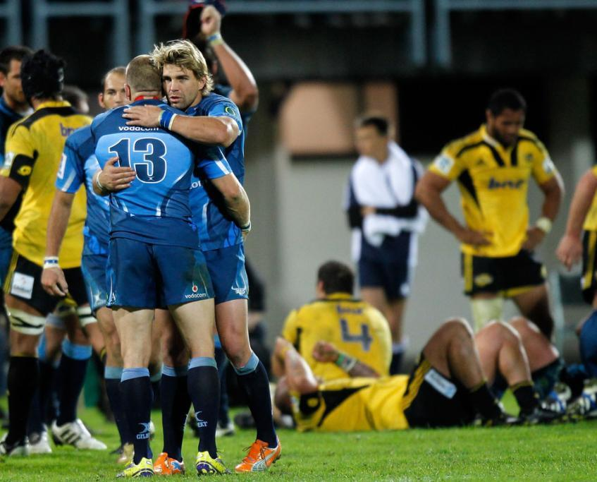 Jaco Pretorius and Dewald Potgieter of the Bulls celebrate their win over the Hurricanes.