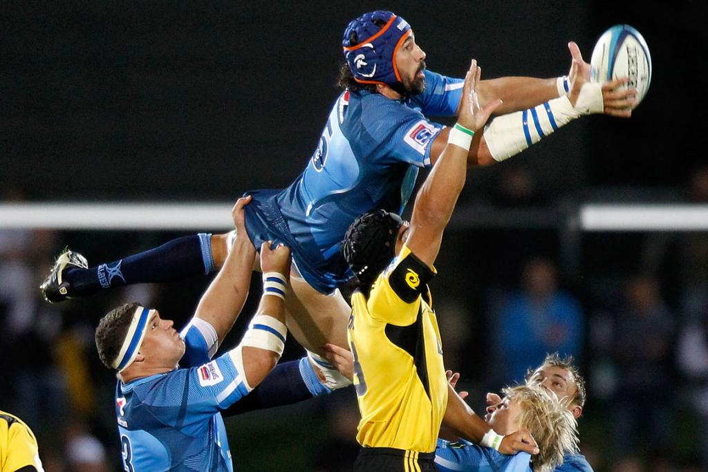 Captain of the Bulls Victor Matfield jumps for the ball against the Hurricanes.