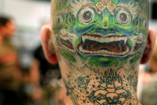 An unidentified man from Budapest sporting a tattoo on the back of his head, attends a tattoo convention in Frankfurt in 2005.