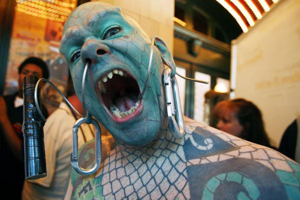 Erik Sprague, also known as the Lizard Man, poses during Ripley's Believe It Or Not! Odditorium grand opening in Times Square in New York 2007.
