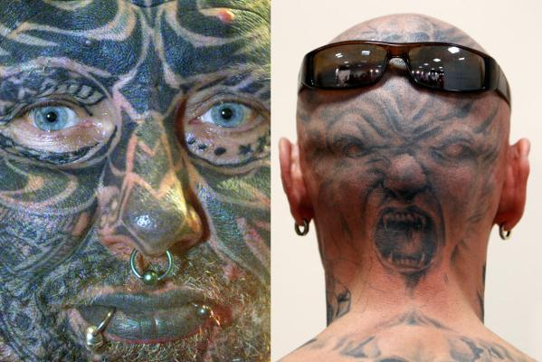Reinhold, 50, from Germany (left), whose body is covered with tattoos, looks at photographers at the Artline Tattoo festival in Bruges in 2001 while at right a man displays his tattoo during a 2011 international tattoo exhibition in Budapest.