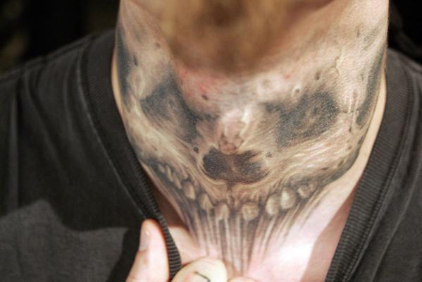 Dan Kollmeo shows off the tattoos on his neck during the ninth Annual New York City Tattoo Convention in 2006.