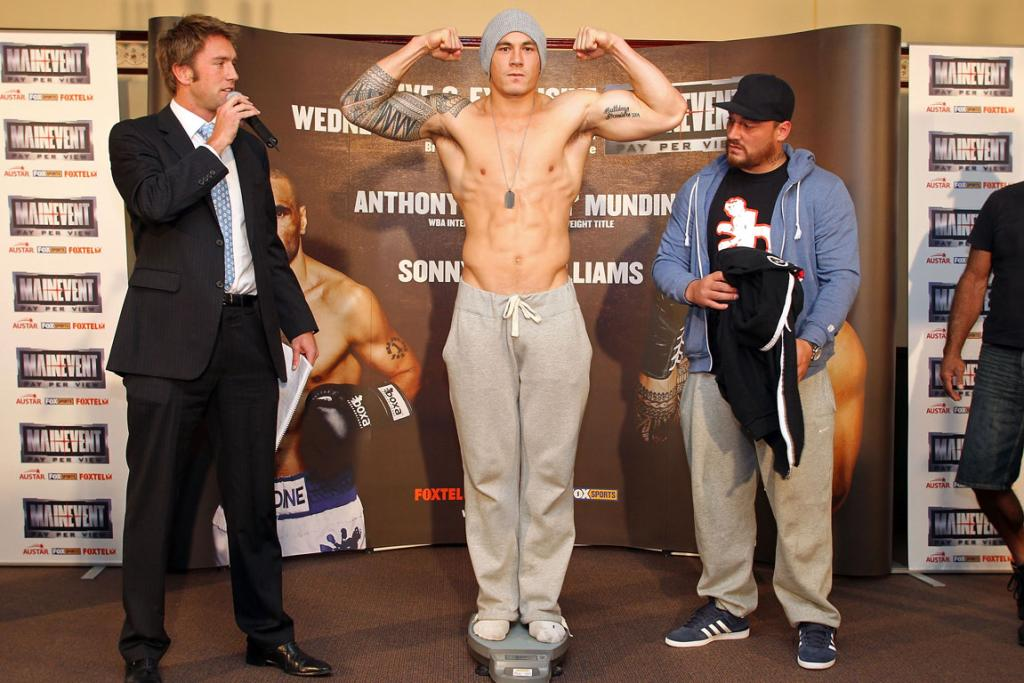 Sonny Bill Williams poses on the scales at the official weigh-in against Ryan Hogan in the under card to the Anthony Mundine and Jorge Miranda fight.